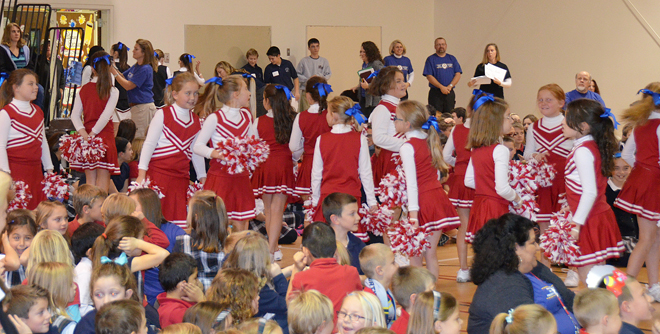 Members of the Our Lady of the Presentation cheerleading squad help keep the excitement high as students, faculty and staff, parents and visitors celebrate the school being named a National Blue Ribbon School at an assembly Nov. 21. (Marty Denzer/Key photo)