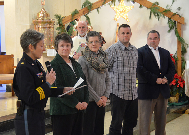 Kansas City Police Maj. Diane Mozzicato announces to the descendants of Sgt. Frank McNamara that a bench along the department's Trail of Heroes honoring McNamara has been donated by St. Therese Little Flower Parish. Sgt. McNamara was killed in the line of duty 112 years ago. Receiving the honor are his great-grandaughters Mary Jo Fisk and Kathleen Aylward, great-great-grandson Jason Williams and great-grandson John Scanlon. (Kevin Kelly/Key photo)