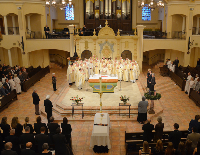 Father Patrick Rush, pastor of Visitation Parish, celebrates the Dec. 22 funeral Mass of Father Norman Rotert with Bishop Robert W. Finn and 37 priests. (Kevin Kelly/Key photo)