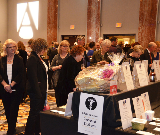 Guests bid on silent auction items at the Steer Dinner held at the Marriot Muehlebach Tower on Feb. 7. (Marty Denzer/Key photo)