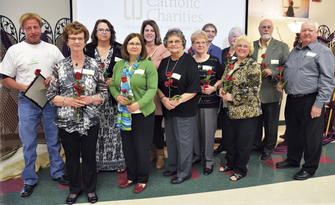 Twelve people were present to receive Blessed Mother Teresa Awards at the Catholic Charities' Reflections of Hope luncheon March 12 at Our Lady of Guadalupe Parish in St. Joseph. From left, they are David Waltemath, Ellen Remick, Karen Nold, Mary George, Julie Houser, Josephine Jackson, Nancy Hopper, Linda Wilt, Janet Fite, Ada Mae Wilmes, John Bitunjac and Jerry Dishman. (Kevin Kelly/Key photo)