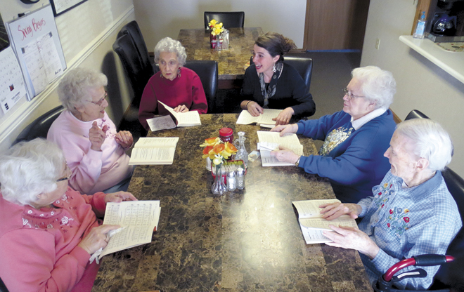 Francesca Brownsberger, top right, from St. Gregory Barbarigo Parish, leads a Bible study class with,  from left, Marjorie Rasco, 93; Beverly Warner, 87; Rose Robbins, 96; Dona Kaminski, 83; and Helen Muldrew, 87. (Kevin Kelly/Key photo)