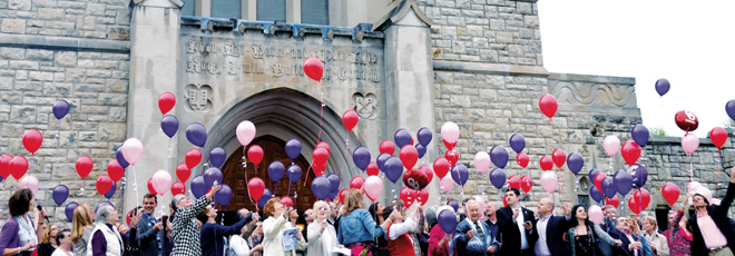 Red, pink and purple balloons sail into the skies April 13 in front of St. Peter's Church in Kansas City. The balloon release followed a memorial Mass honoring the three victims of the shootings April 13, 2014 at the Jewish Community Campus in Overland Park. (Marty Denzer/Key photo)