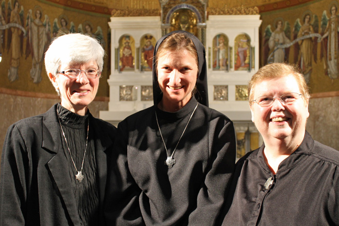 Sister Maria Gara, OSB (center) has made her First Monastic Profession with the Benedictine Sisters of Perpetual Adoration in Clyde, Mo. She is joined by (left) Sister Pat Nyquist, OSB, her formation director and Prioress General Sister Dawn Annette Mills, OSB. (photo courtesy of BSPA)