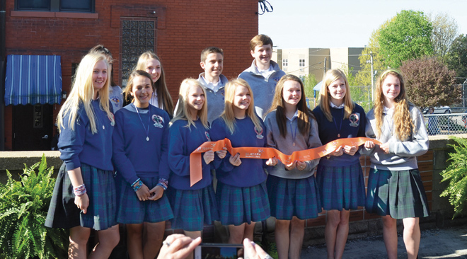 The Legacy Project committee of the Cathedral Class of 2015 holds the cut ribbon to celebrate the dedication of the gardens, outdoor classroom and Wall of Honor on May 1. (Marty Denzer/Key photo)