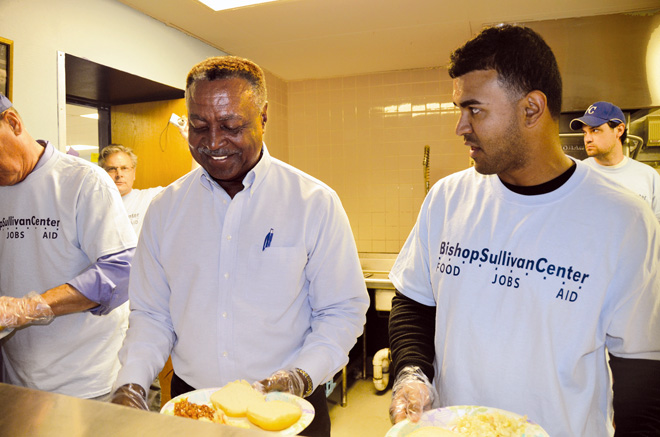 Royals legend Frank White joined Royals infielder Christian Colon May 4 in the serving line at St. James Place, the midtown community kitchen operated by the Bishop Sullivan Center. Colon is leading efforts to raise money and awareness of hunger for the Bishop Sullivan Center.  (Kevin Kelly/Key photo)