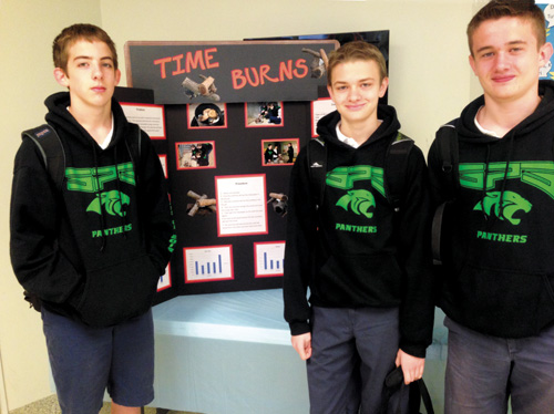"St. Patrick eighth grade scientists, Tristan Hurt, Adam Catlin and George Lofland brought home the Missouri Department of Conservation's Science Pioneer Award, for their Greater Kansas City Science and Engineering Fair experiment, ""Time Burns."" (Photo courtesy Amy Gamble, St. Patrick School)"