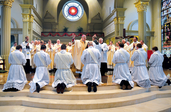 Bishop Robert W. Finn ordained seven men to the diocesan priesthood May 23 at the Cathedral of the Immaculate Conception. They are Bryan Amthor, Joshua Barlett, Ryan Koster, Gabriel Lickteig, Jorge Andres Moreno, Luis Felipe Suarez and Curt Vogel. (Kevin Kelly/Key photo)