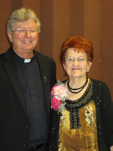 House of Bread founder Fr. Joe Nassal, C.PP.S., and retiring House of Bread Coordinator Marie Lederer pose for a picture at a reception honoring Marie's 33 years of service to the House of Bread. (Key photo courtesy St. Francis Xavier Parish)