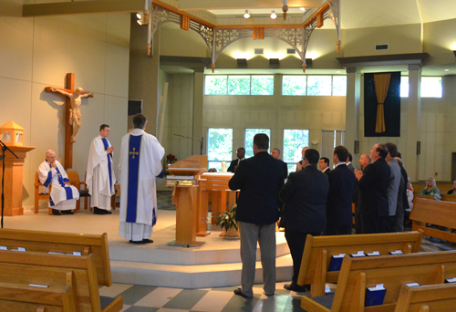 Vicar General Father Charles Rowe formally accepted thirteen men into candidacy for the permanent diaconate at a Mass June 20 at St. Patrick Parish in Kansas City, North. (Kevin Kelly/Key photo)