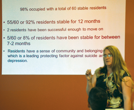Christina Taylor, site services coordinator at St. Michael's Veterans Center shares success stories at the center's first anniversary celebration June 30. Center officials also announced Phase II which will double the number of apartments for homeless military veterans to 118, while adding a service center to serve all military veterans in need. (Kevin Kelly/Key photo)