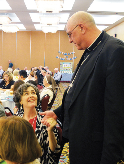 Kansas City, Kan., Archbishop Joseph F. Naumann speaks with Amy McInerney, executive director of the National Committee for a Human Life Amendment following the archbishop's opening keynote address July 27 at the annual Diocesan Pro-Life Leadership Conference in Kansas City, Mo. (Kevin Kelly/Key photo)