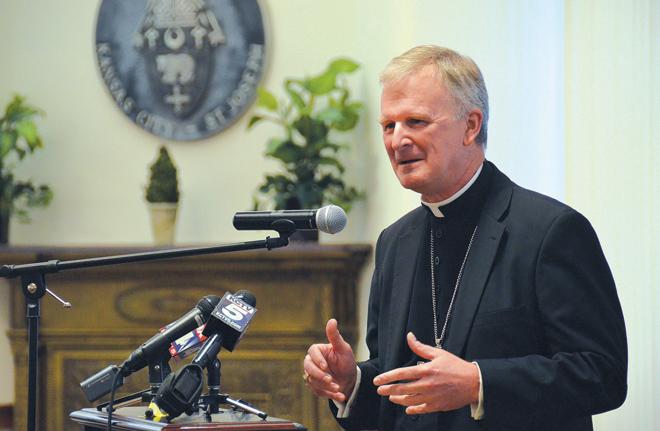 Bishop-designate James Johnston addresses staff members of the Catholic Chancery and Catholic Charities Sept. 15 at The Catholic Center. (Joe Cory/Key photo)