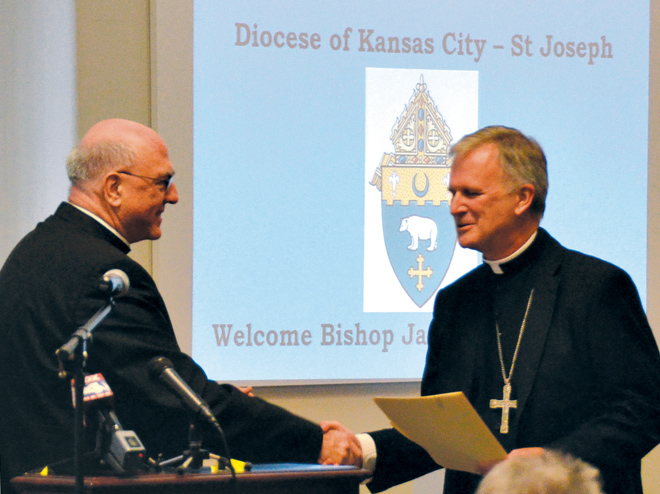 Archbishop Joseph F. Naumann is the first to officially welcome Bishop James V. Johnston at the press conference announcing his appointment as the seventh Bishop of Kansas City-St. Joseph on Sept. 15. (Joe Cory/Key photo)