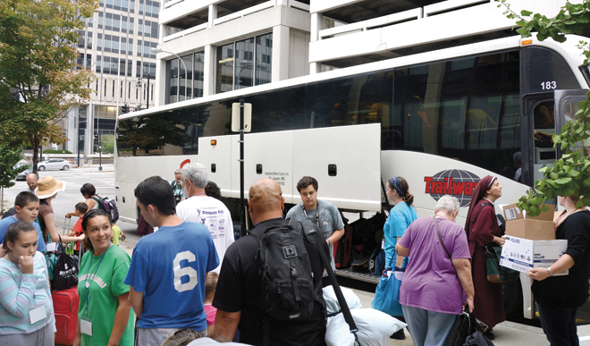 Pilgrams wait to load their luggage on the bus that will drive them 23 hours to Philadelphia for a chance to see Pope Francis. (Joe Cory/Key photo)