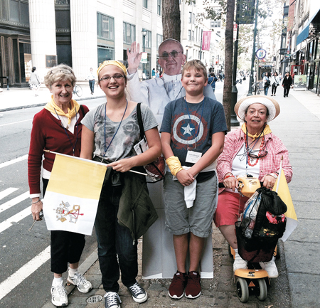 Posing with Pope Francis are l-r Mary Sweat, Elayna Marquis (14), Luke Marquis (13), and Edna Perez-Koury. (photo courtesy Kristen Marquis)