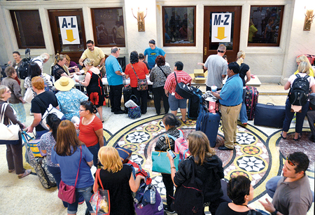 The lines to register at the Catholic Center on Sept. 23 were likely the first of many for the 325 people on their pilgrimage to see Pope Francis in Philadelphia. (Joe Cory/Key photo)