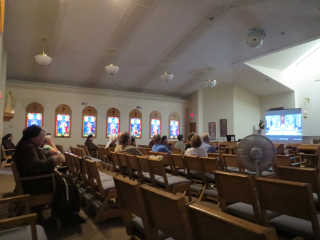 A group of Kansas City area Serra Club members joined the Sisters of St. Francis of the Holy Eucharist as they watched the telecast of Pope Francis and the canonization of St. Junipero Serra Sept.  23 at the sisters' chapel in Independence. (Kevin Kelly/Key photo)