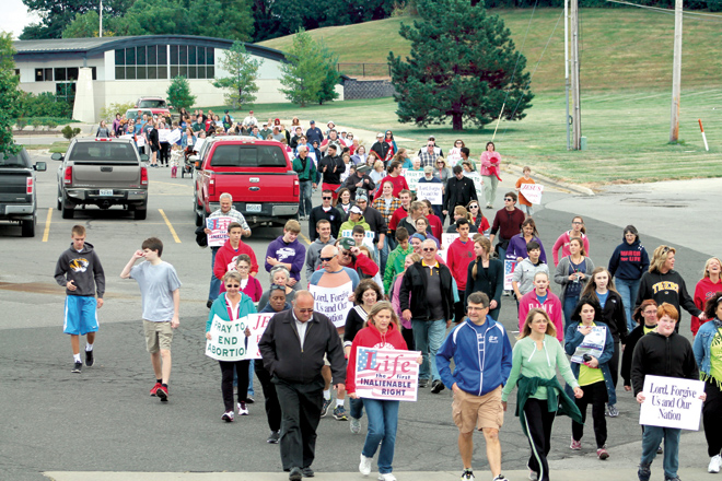A long line of marchers took part in the Walk for Life in St. Joseph on Sunday, Oct. 4, an activity helping kick off Respect Life Month. The participants formed a  line going through a commercial area toward Bishop LeBlond High School, where Life Day 2015 took place at the stadium. (photo courtesy Ken Newton)