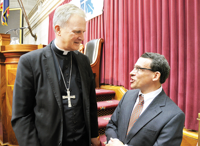 Dr. Lawrence Feingold speaks with Kansas City-St. Joseph Bishop-designate James V. Johnston Jr. following Feingold's keynote address Oct. 3 at the annual Missouri Catholic Conference Assembly in Jefferson City. (Kevin Kelly/Key photo)