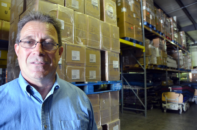 Paul Wilson looks over a warehouse filled with medical equipment and supplies, ready to be shipped from the Franciscan Mission Warehouse to hospitals and clinics serving the poor in the Third World. (Kevin Kelly/Key photo)