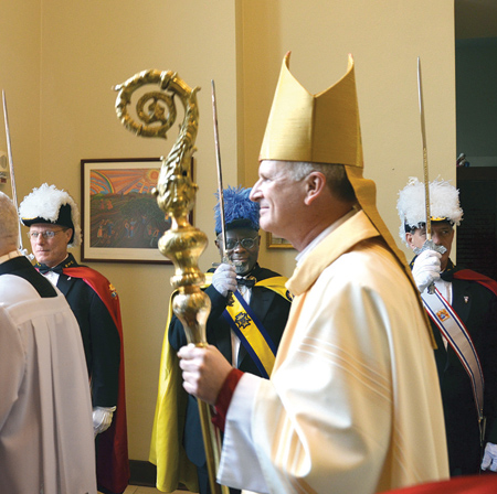 Bishop Johnston carries his crozier as he exits the Cathedral flanked by a Knights of Columbus honor guard. (Joe Cory/Key photo)