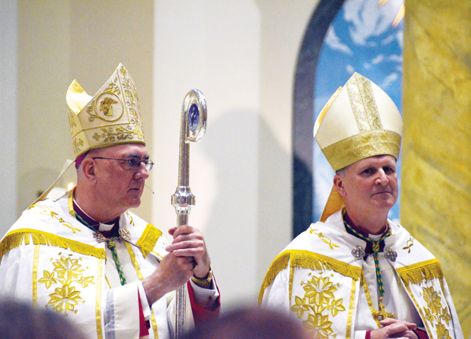 Archbishop Joseph Naumann introduces Bishop James V. Johnston, Jr. at the Cathedral of St. Joseph Vespers service Nov. 3. (Joe Cory/Key photo)