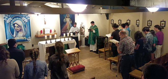 Missouri Western University students attend a Sunday Mass in the chapel of the Catholic Newman Center. (Photo courtesy Leeds Haroldson)