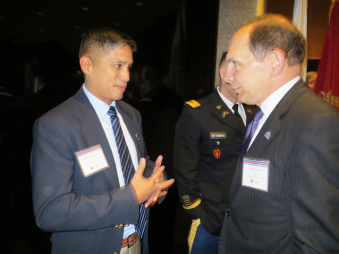 Eric Verzola, director of veterans services for Catholic Charities of Kansas City-St. Joseph, speaks with U.S. Veterans Affairs Secretary Bob McDonald during a break in the Oct. 29 Veterans Employment Summit at the Liberty Memorial National World War I Museum in Kansas City. (Kevin Kelly/Key photo)