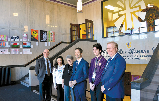 In the newly remodeled and lighter entry to Cristo Rey-KC stand from left, Bob Erickson, St. Joseph Medical Center CEO, senior Lessly Ceniceros,  Dr. Kathleen Hanlon, president of Cristo Rey-KC High School, Luis Leon, Prime HealthCare Services President of Operations II, senior Avery Shook and Randy Nyp, CEO of Providence Medical Center. (Marty Denzer/Key photo)