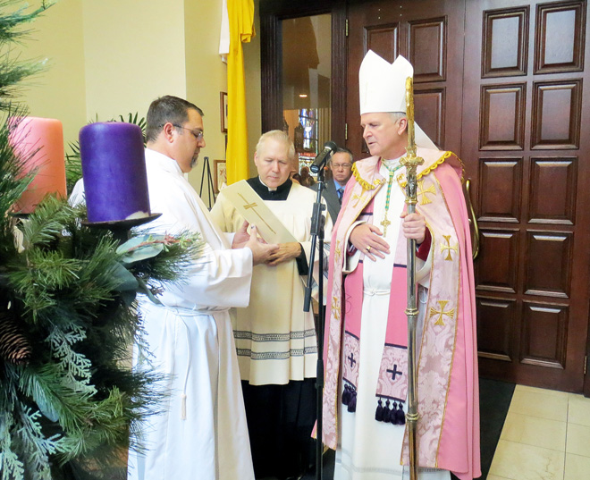 Bishop James V. Johnston Jr. prepares to walk through the Holy Door at the Cathedral of the Immaculate Conception in downtown Kansas City Dec. 13. (Kevin Kelly/Key photo)