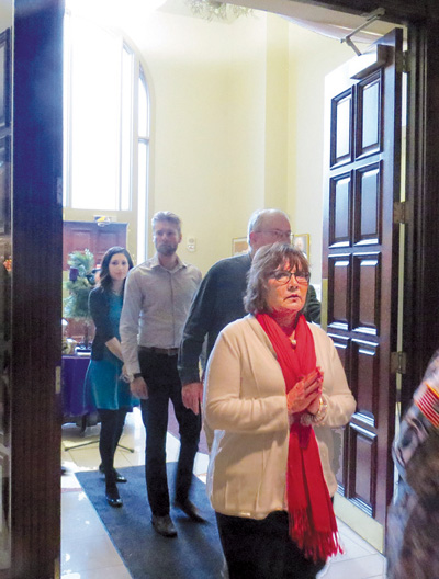 Parishioners and others who attended the 11 a.m. Dec. 13 Mass cross the threshold of the Holy Door at the Cathedral of the Immaculate Conception in downtown Kansas City. (Kevin Kelly/Key photo)