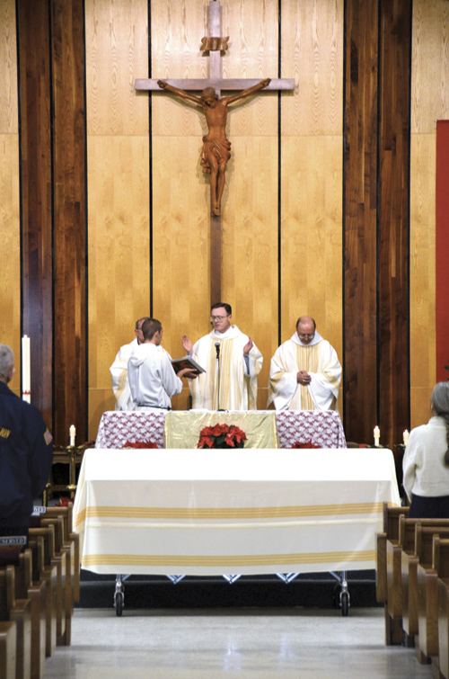 Benedictine Father Allan Stetz, Diocesan Vicar General Father Charles Rowe and Benedictine Abbot Gregory Polan concelebrate the Mass of Christian Burial for Deacon Martin Goedken Jan. 4 at St. Columba Parish in Conception Junction. (Kevin Kelly/Key photo)