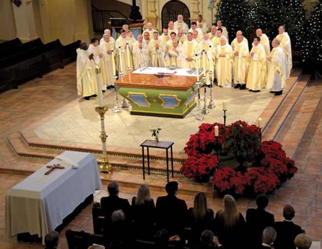 Priests of the Kansas City-St. Joseph Diocese concelebrate Dec. 30 with Visitation Parish pastor Father Pat Rush at the Mass of Christian Burial for one of their brother priests, Father John Wandless. (Kevin Kelly/Key photo)