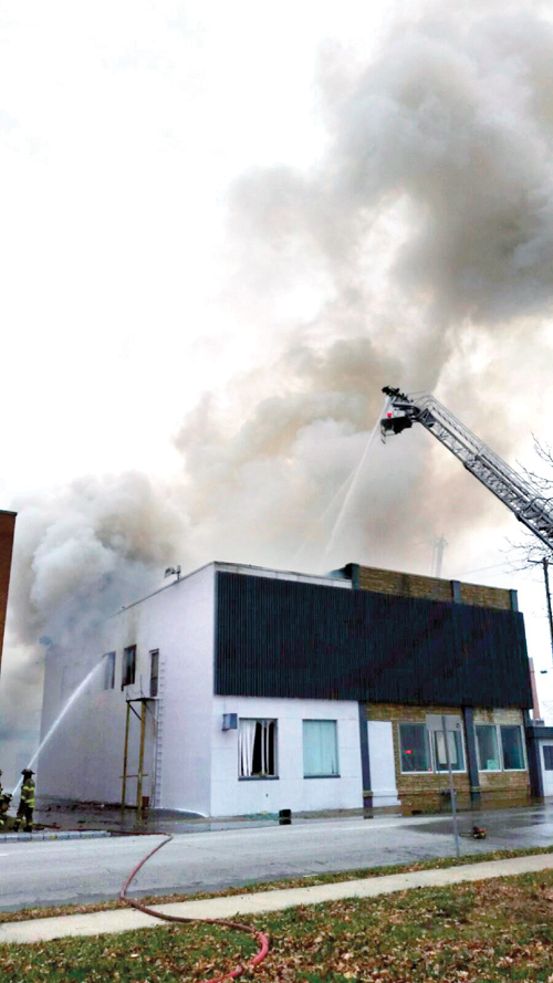 A fire of undetermined cause raged through the building in downtown St. Joseph Dec. 27 that was to become the Deacon Martin Goedken Center, the headquarters for Catholic Charities in northwest Missouri.