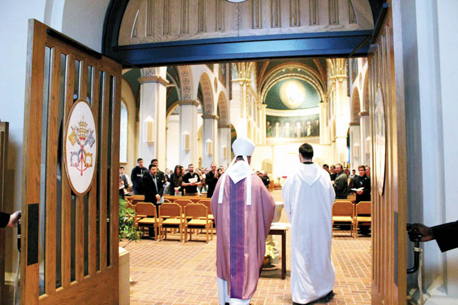 Abbot Gregory Polan, OSB enters through the Holy Doors at Conception Abbey's Basilica of the Immaculate Conception at a ceremony dedicating them on Gaudete Sunday. (photo courtesy of Conception Abbey)