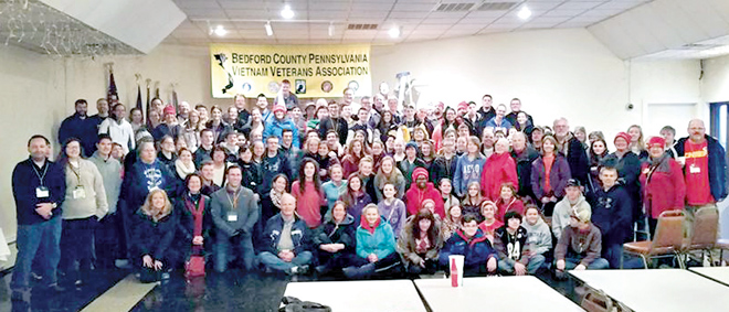 """After their ordeal on the Pennsylvania Turnpike, all 165 March for Life pilgrims posed for a """"family portrait"""" at the American Legion Hall in Bedford, Pa., where they spent the night of Jan. 23-24. (photo courtesy of Deacon Rick Boyle)"""
