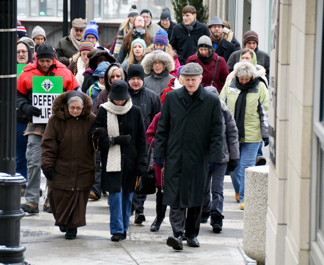 In sub-freezing weather, Bishop James V. Johnston, right, leads a procession of pro-lifers from the Catholic Center in downtown Kansas City to Ilus Davis Park across from the Charles Evans Whittaker U.S. District Courthouse Jan. 22 for the annual protest on the 43rd anniversary of the Roe v. Wade and Doe v. Bolton decisions legalizing abortion. (Kevin Kelly/Key photo)
