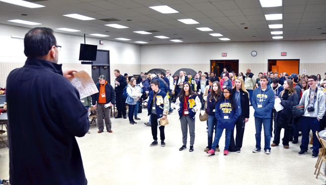 Respect Life Director Bill Francis gives pilgrims final instructions Jan. 20 before boarding buses at St. John LaLande Parish in Blue Springs. Nearly 165 people made the diocesan-sponsored trip to Washington, D.C., for the annual March for Life to defend the lives of the unborn. (Kevin Kelly/Key photo)