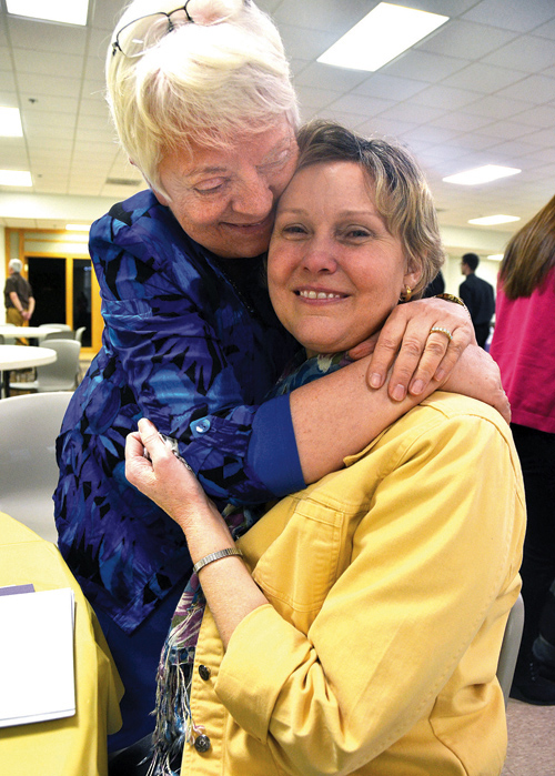 Project Rachel founder Vicki Thorn, left, hugs Teresa Hoeppner, director of the spiritual healing ministry for women who have had abortions for the Diocese of Kansas City-St. Joseph following a workshop for priests Jan. 26 at Church of the Nativity in Leawood, Kan. (Kevin Kelly/Key photo)