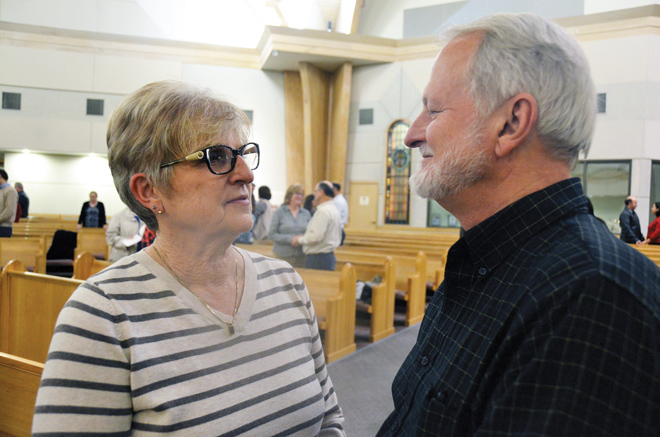 Linda and Phil Voyles renew their marriage vows during the World Marriage Day Mass celebrated Feb. 11 at their home parish, Holy Trinity in Lenexa, Kan. The Voyles have been married for 45 years. (Kevin Kelly/Key photo)