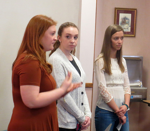 St. Pius X High School students Katie Pileggi, Katie Rainey and Emma Meinking told parishioners at Holy Trinity Parish in Weston March 6 of their plans to install another 60 water filtration systems during their annual mission trip to Guatemala in June. (Kevin Kelly/Key photo)