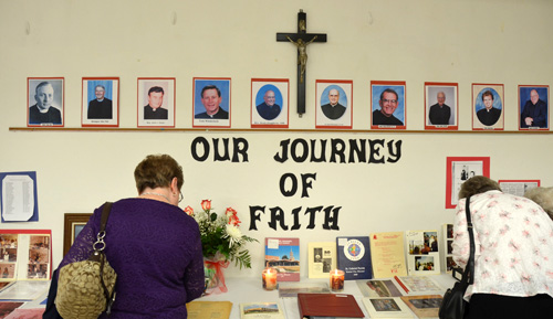Parishioners, past and present, enjoyed perusing photo albums and other memorabilia of St. Gabriel's 60 years. (Marty Denzer/Key photo)