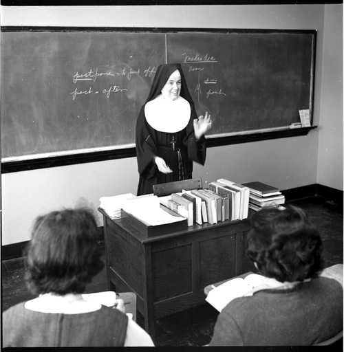 Sister Marcella Marie Holloway CSJ, teaches an English class in Donnelly Hall, on the St. Teresa's Academy campus, Dec. 1960. The college moved to 119th and Wornall Road in 1962. (Photo courtesy Avila University)