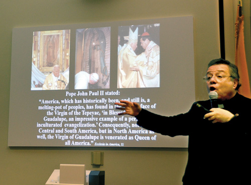 "Msgr. Eduardo Chavez, renowned Our Lady of Guadalupe expert, examines the mysteries of the image of the ""Queen of all America."" (Marty Denzer/Key photo)"