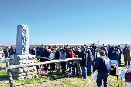 A stone monument to eight victims of the crash of TWA Flight 599 March 31, 1931, stands on the crash site. The quinquennial memorial draws family, fans and friends to the Kansas cow pasture to remember and honor them. (Marty Denzer/Key photo)