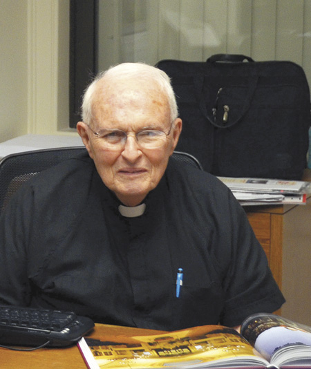 Father Michael Coleman, JCL, co-author of This Far By Faith, the diocesan history, and author of Further by Faith, the art and architecture of the diocese (above). (Marty Denzer/Key photo)