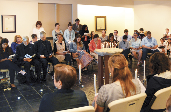 Young and older, members of the Rockhurst University community and Catholic and Jewish communities across Kansas City, join in remembering the lives lost to the Nazis in World War II. (Marty Denzer/Key photo)
