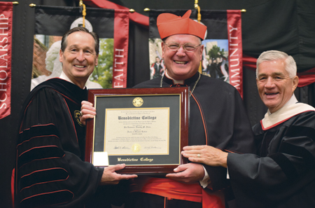 Cardinal Dolan receives an honorary degree from Benedictine President Stephen Minnis and Benedictine Board Chair Jack Newman. (photo courtesy of Benedictine College)