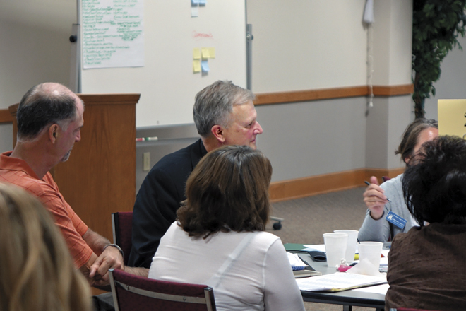 participates in a two-day retreat seeking to provide input for a new strategic plan for Catholic schools. (LeAnn Lakin/photo)